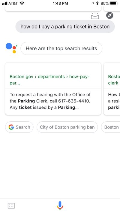 """Google Assistant app on iPhone with the results of a """"how do I pay a parking ticket in Boston"""" query, showing results only weakly related to the intended content."""